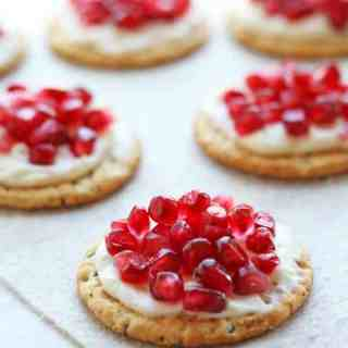 Crackers with Cream Cheese and Pomegranate Arils