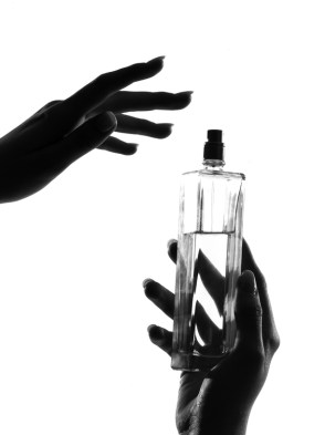 detail close-up silhouette woman hands with perfume
