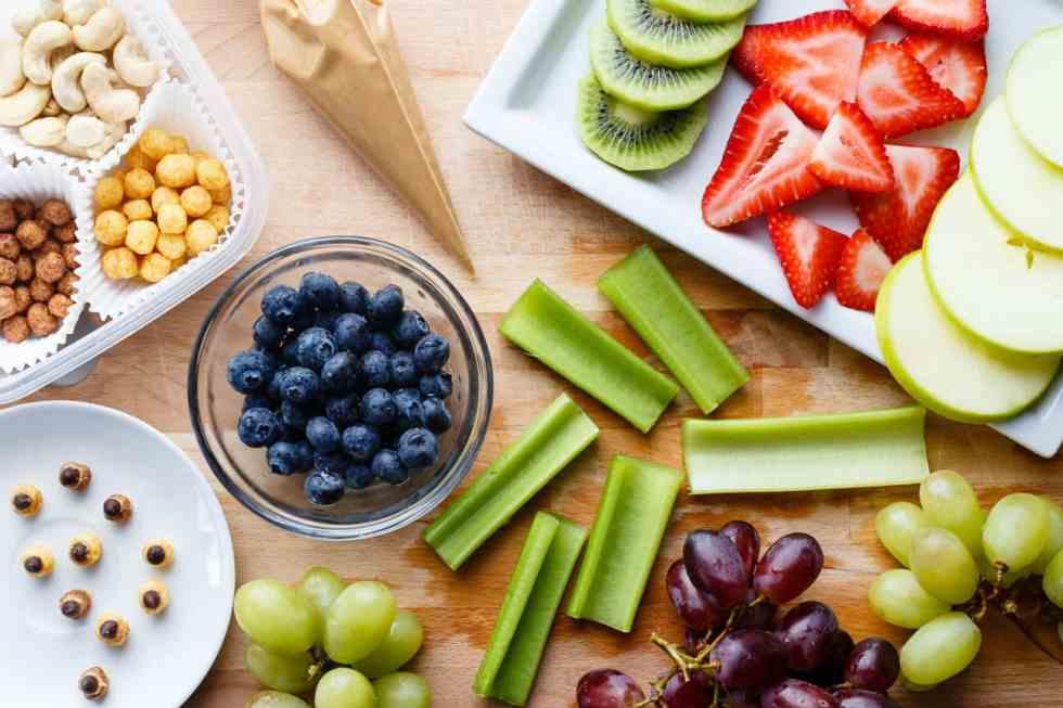 Cut fruit and vegetables prepared for making fruit bug snacks.