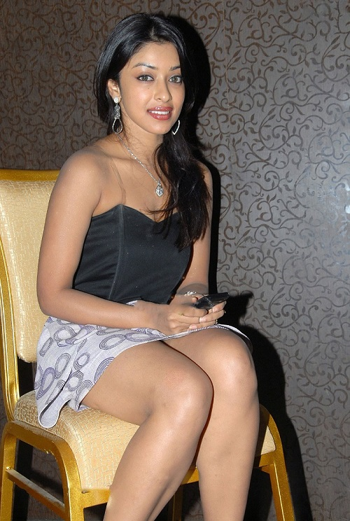 Payal Ghosh Hot Photos In While Sitting In Mini Skirt