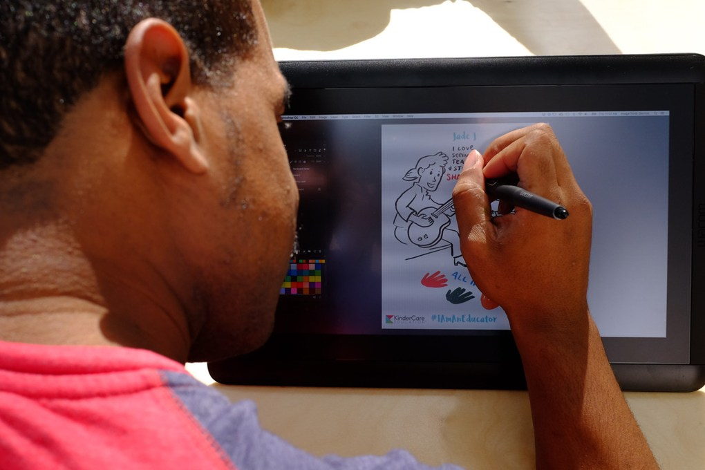 ImageThink graphic recorder working to illustrate key elements of a narrative on a Wacom Cintiq tablet.