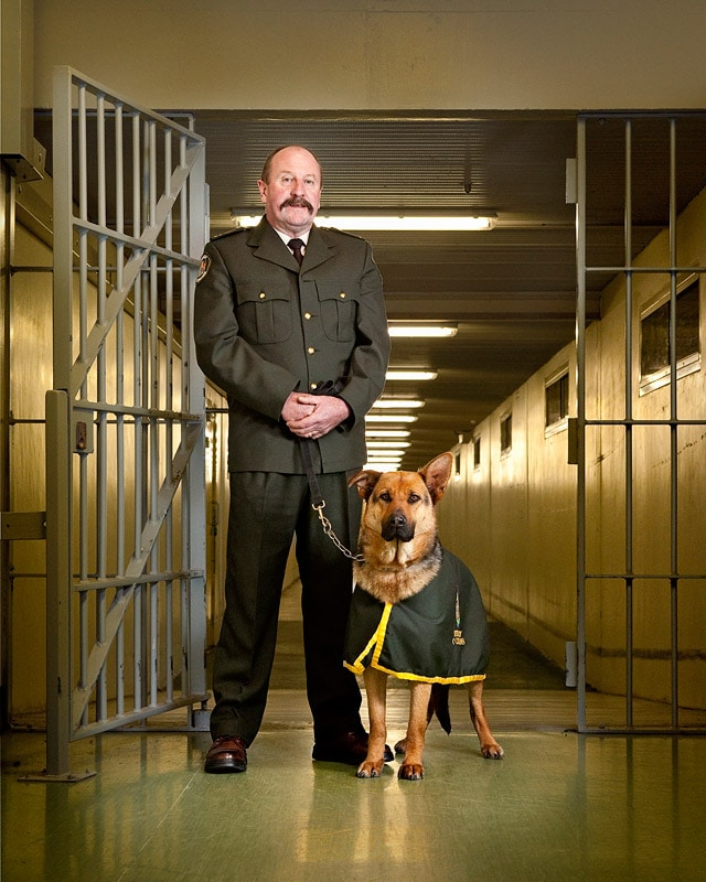 Formal portrait of Corrections Officer Barry Nelsen and his drug detector dog Ollie