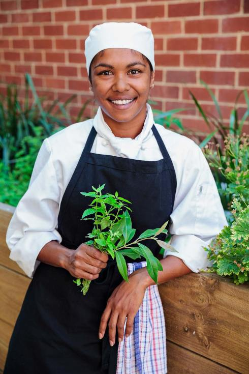 Hospitality student with herbs