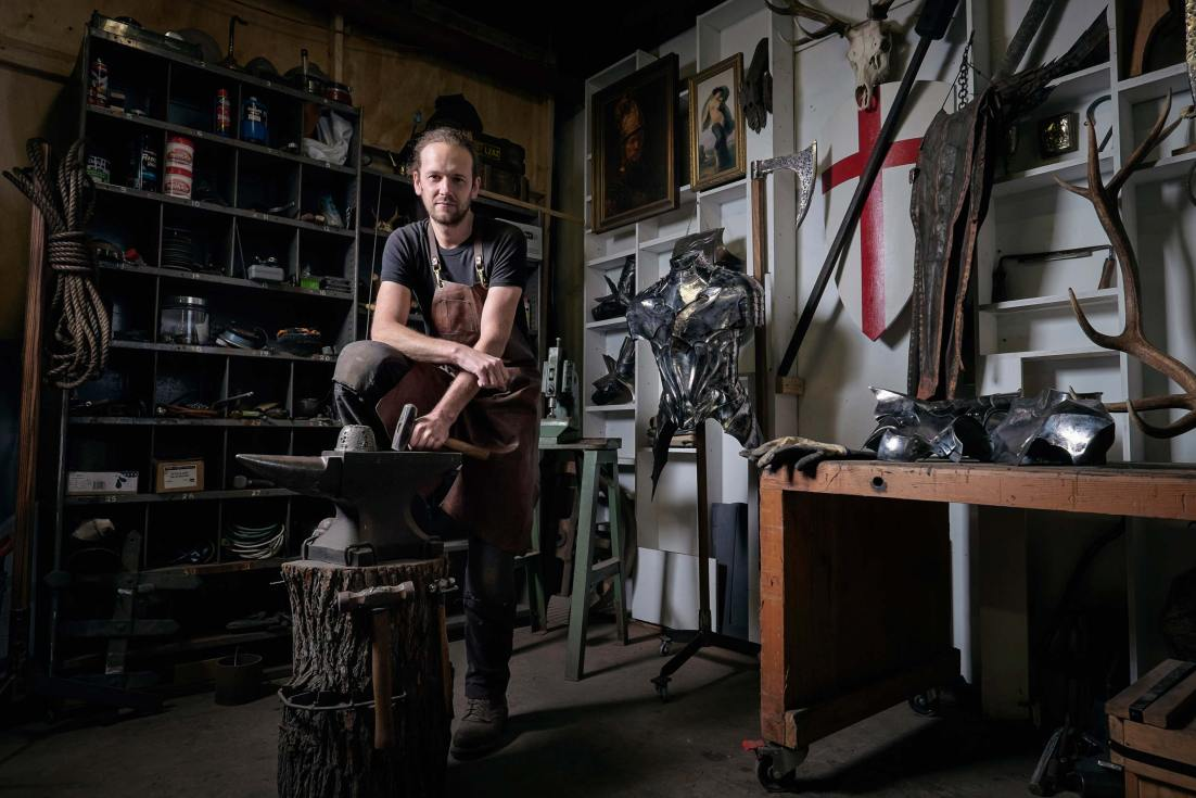 Dark and evocative environmental portrait of Lord Bloomfield; a modern day armorer, sculptor and artist.