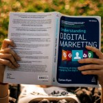 Digital Marketing Resources girl lying on a blanket reading digital narketing book