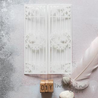 Birdcage Laser Cut Range - White. pearlised white laser cut wedding invitation.