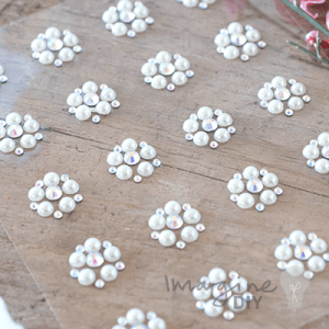 small pearl and crystal decorations to stick on to wedding invitations . Self adhesive pearl and crystal embellishments