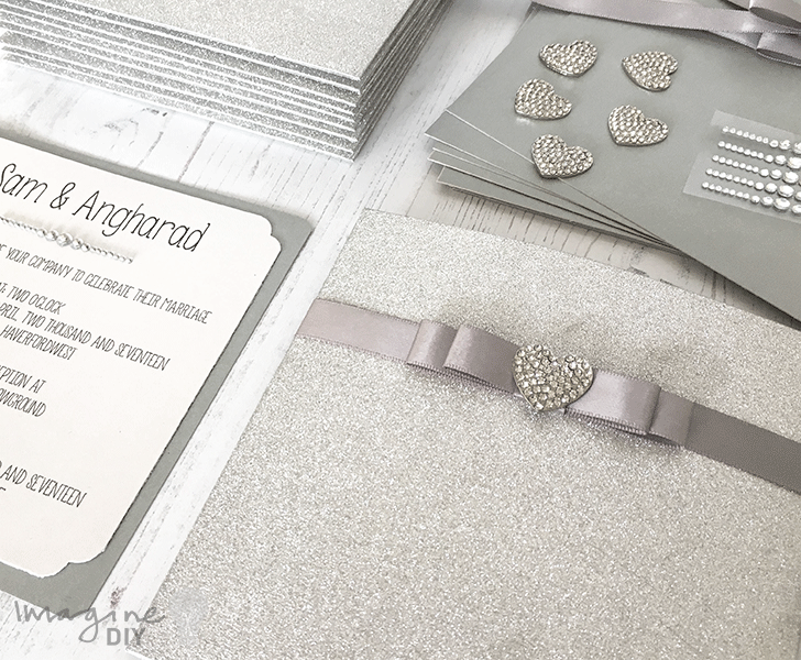 DIY wedding invitation. Silver glitter invitation with crystal heart embellishment. DIY wedding stationery supplies