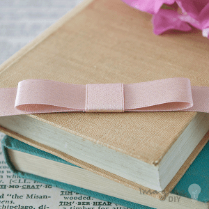 rose gold single dior bow. Pre tied bows. Pre made bow in rose gold ribbon. DIY wedding stationery supplies