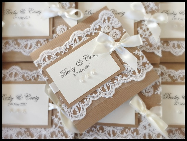 Rustic wedding invitation with lace and pearls