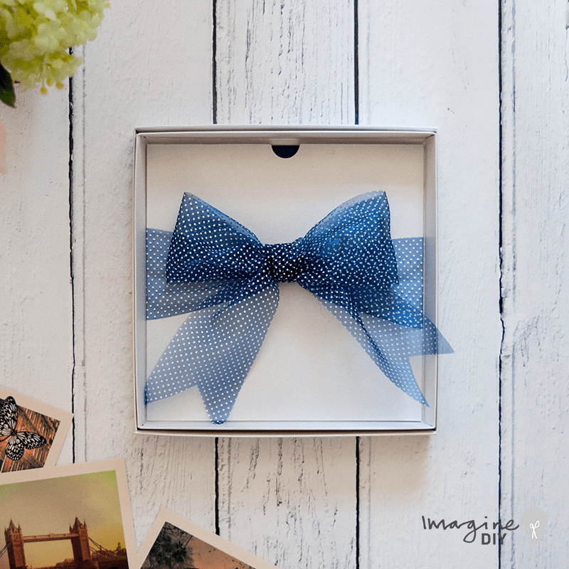Navy and white wedding invitation ideas. Make your own wedding stationery with polka dot ribbon. Boxed wedding invitations to make yourself