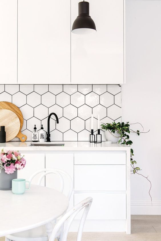 Gorgeous white kitchen with hexagonal tile backsplash