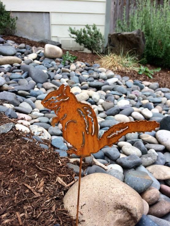 eating chip munk yard art