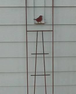 Bird on swing trellis