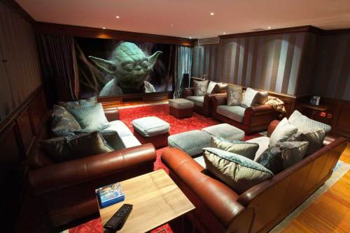 Family media room with projector and screen.