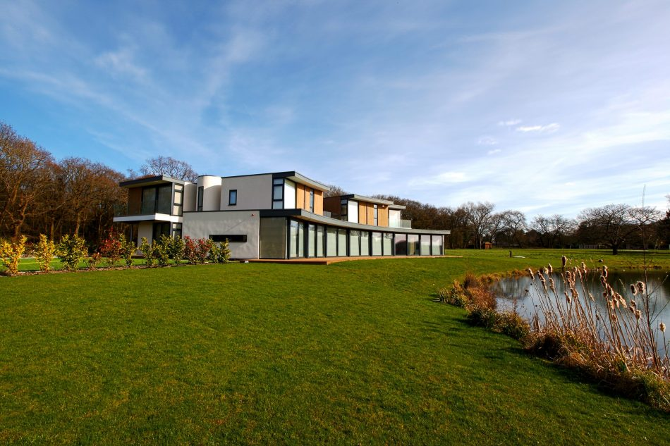 Shows house from the lake with Lutron motorised blinds down