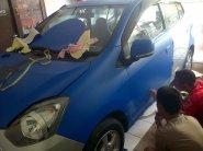 wrapper imagi sedang membungkus mobil agya