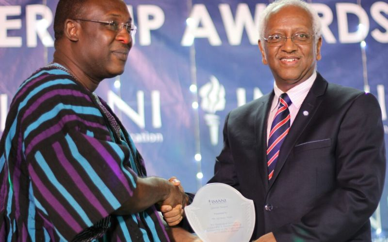 Mr. Girmay Haile, UNAIDS Country Director for Ghana, receiving and award from Imani Vice President Kofi Bentil
