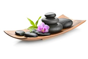 Massage stones in a basket