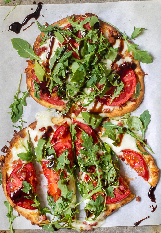 Tomato, Mozzarella & Arugula Naan Pizza with Pancetta and a delicious Balsamic glaze #pizza