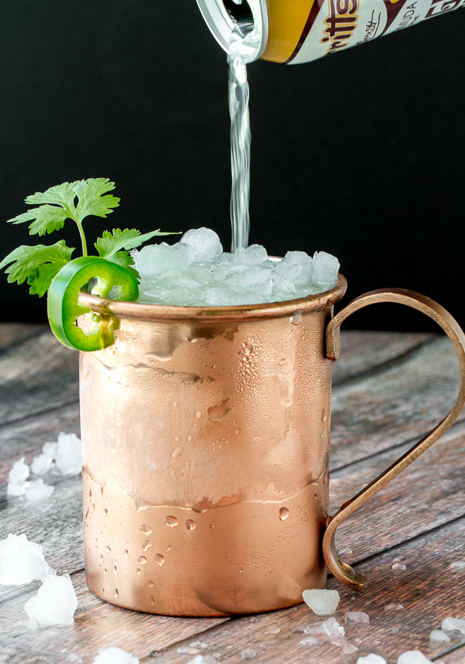 A Mexican Mule made with tequila, jalapeño, cilantro, ginger and orange liqueur and of course lime and ginger beer!  Such a delicious spin on the Moscow Mule!