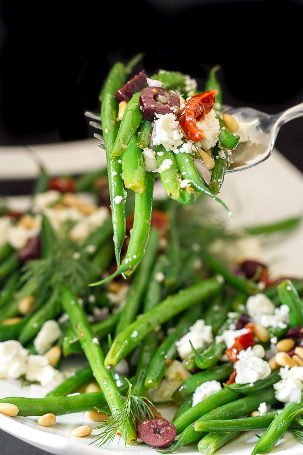 Greek green beans with kalamata olives, sun dried tomatoes, feta cheese, pine nuts and dill.