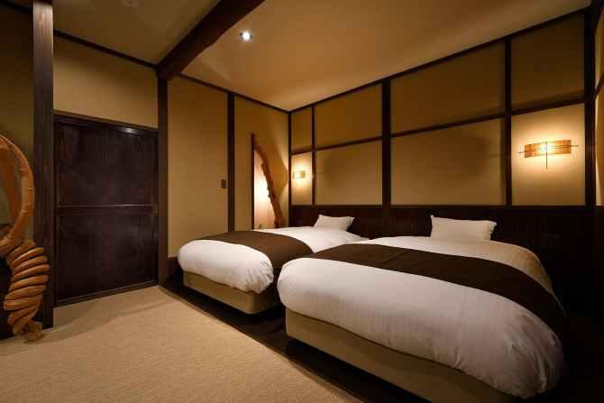 【蛍雪の宿 尚文】母屋 露天風呂付き INAKAスイート(70平米)のベッドルーム