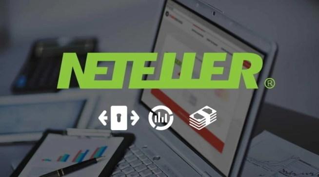 Il logo di NETELLER con un laptop sullo sfondo.