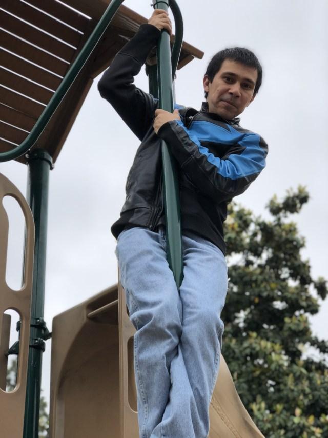 Robert slides down a pole