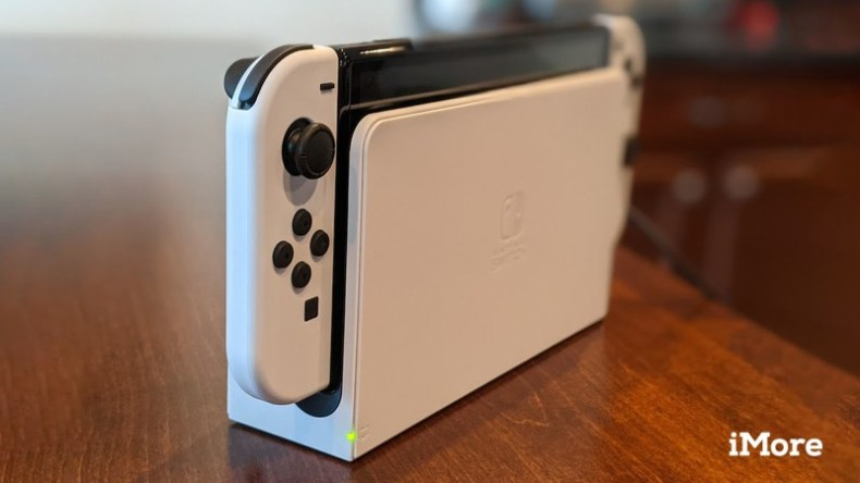 Nintendo Switch Oled Model In Dock Light On