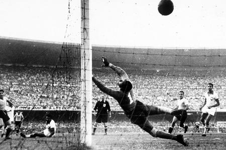 World Cup Final, 1950. Brazil. Maracana Stadium, Rio De Jainero. Brazil 1 v Uruguay 2. 16th July, 1950. Uruguay's Ghiggia scores the winning goal past Brazilian goakeeper Barbosa to win the World Cup for Uruguay and complete a major by upset by beating ho