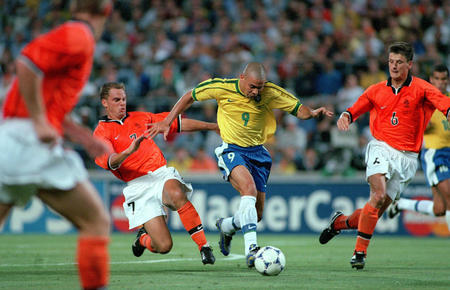 1998 World Cup Finals. Marseille, France. Semi-Final. 7th July, 1998. Brazil 1 v Holland 1. (Brazil won 4-2 on penalties). Brazil's Ronaldo races away as Holland's Wim Jonk (6) and Ronald De Boer try to intercept.