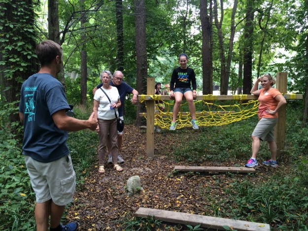 Brent Cummins explaining an obstacle to Kathy and Tom Jenkins, and Sarah and Jen Thomas
