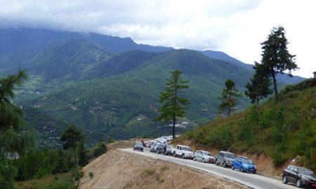 Vehicles lined up near the newly-completed Giant Buddha stupa in Thimphu, Bhutan [Image: Dawa Gyelmo]