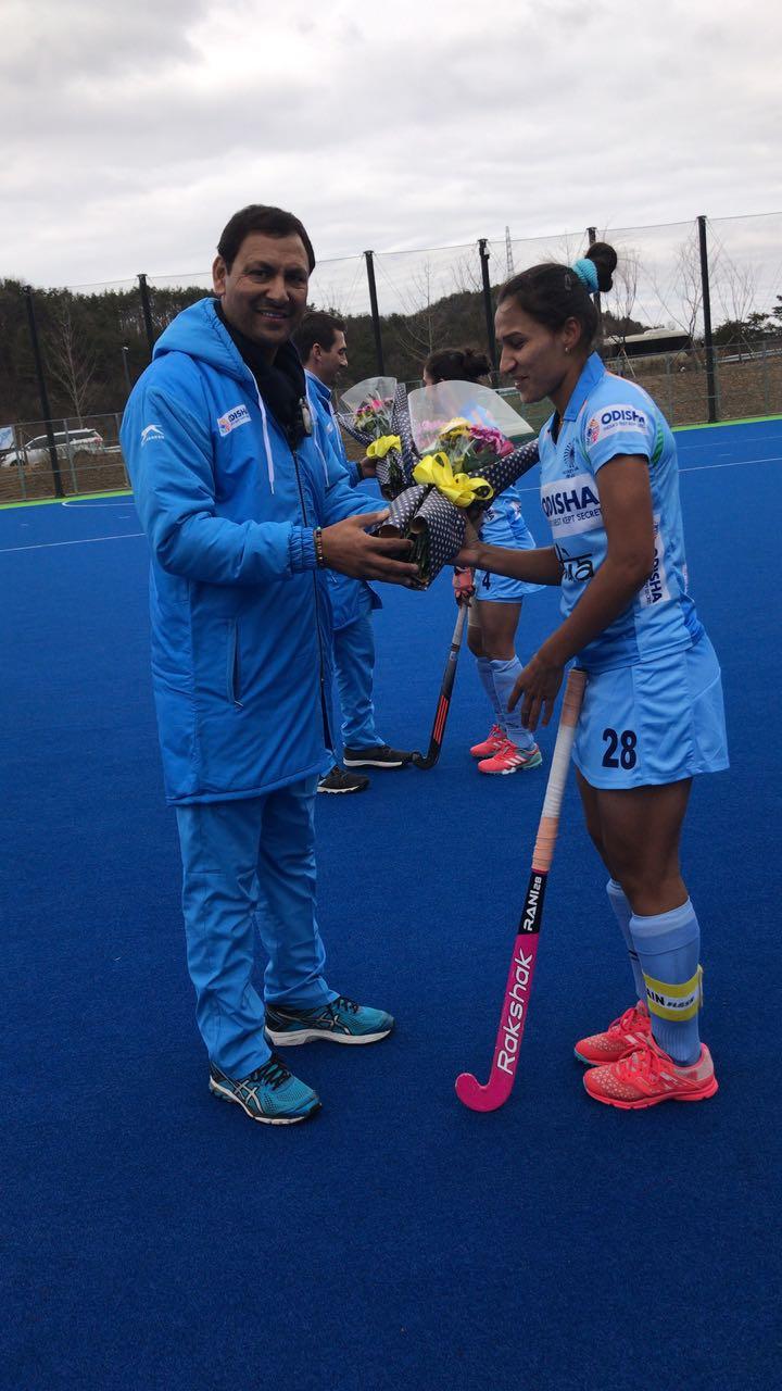Rani being felicitated by Indian Team Chief Coach Harendra Singh in Jinchun, Korea.