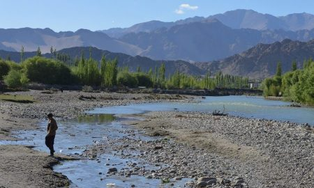 A boy crossing a small channel containing sewage which drains into the Indus near Choglamsar in Leh [image by: Athar Parvaiz]
