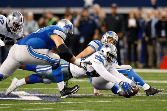 Lawrence dives to recover his second fumble, fearing a Leon Lett moment.