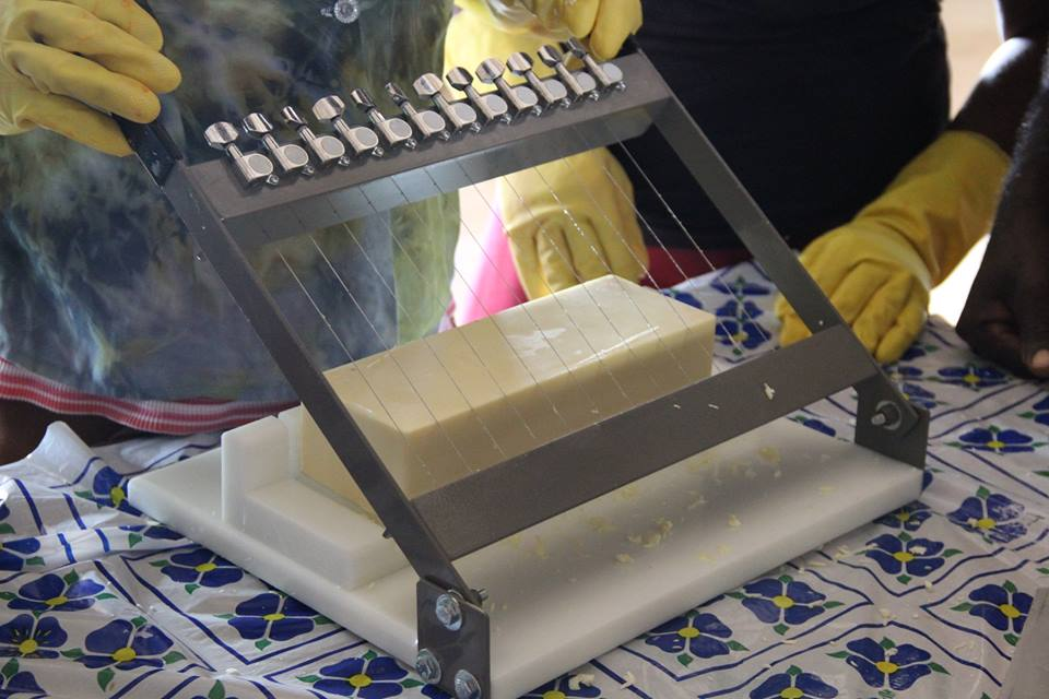 HANDMADE SOAP CUTTER MADE WITH GUITAR STRINGS. SOAP MADE IN MIZAK, HAITI.