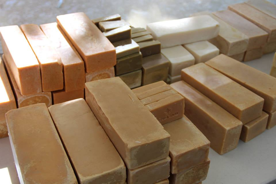 BLOCKS OF HANDMADE SOAP MADE IN PORT-AU-PRINCE, HAITI. TURMERIC, PAPRIKA, ASSO ROSSI SOAP.