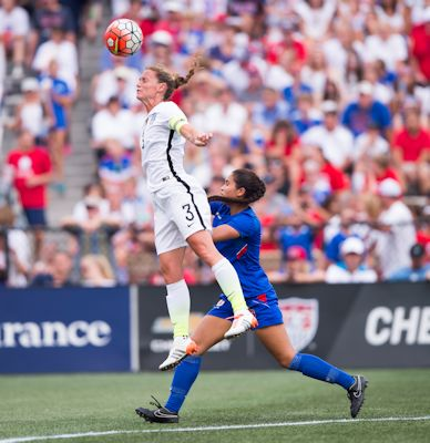Birmingham, AL - September 20, 2015:  The USWNT defeated Haiti 8-0 during the Victory Tour at Legion Field.   Rampone goes for a header.