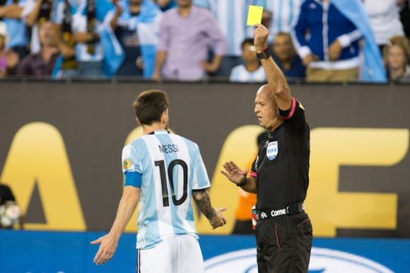 Lionel Messi, Captain of the Argentine team, is not immune to fouling. Center Referee Haber Lopes showed Messi a yellow and cautioned the superstar in last night's final between Argentina and Chile in East Rutherford, NJ. Photo by Jorge Martinez.