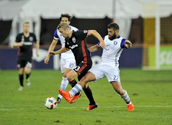 Antonio Nocerinos (purple and white) puts a questionable leg in to get the ball against Julian Buscher on September 24, 2016. Photo by Jose Argueta.