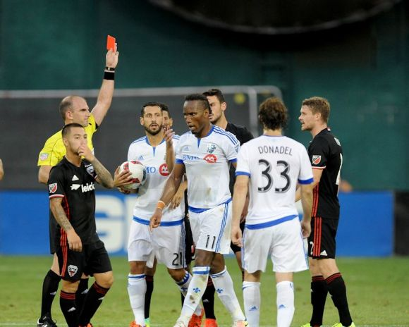 Didier Drogba (center) receives a red card on July 31, 2016 in the match between Montreal Impact and DC United. Photo by Jose Argueta.