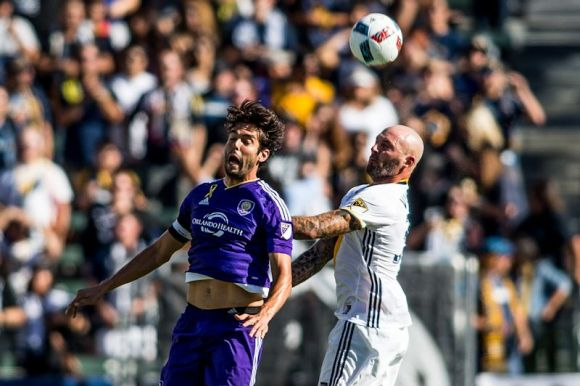 Kaka (purple) battles against Jelle Van Damme at Stub Hub Center on Sept. 11, 2016. Kaka and Orlando lost to the Galaxy 4 - 2. Photo by Michael Janosz.
