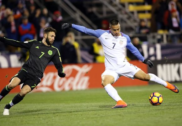 Bobby Woo lines up a shot as Miguel Layun of Mexico goes for the tackle. Photo by Tony Quinn on November 11, 2016 in Columbus, Ohio.