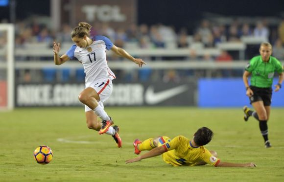An airborne Tobin Heath helps the US defeat Romania 5 - 1 at Avaya Stadium in San Jose on November 10, 2016. Photo by John Todd.