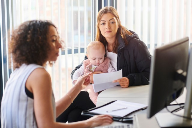 young mother with social services or housing officer