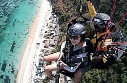 Paragliding above the beautiful Bali coastline.