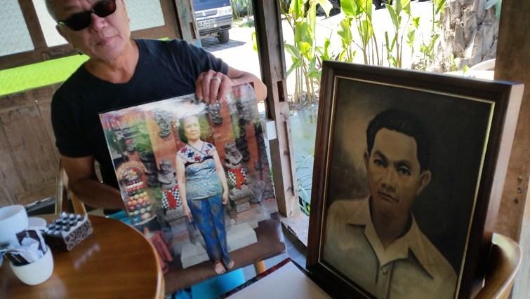 Lonny Gerungan shows images of his parents.