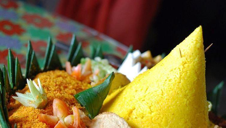Nasi Kuning or yellow rice. Photo by miss_yasmina